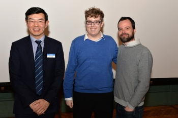 Jake is being congratulated by Wen Wang and Lorenzo Botto